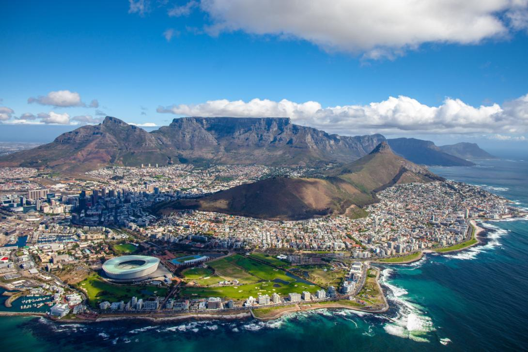 An aerial shot of Cape Town, showing Table Mountain, Signal Hill, and the CBD